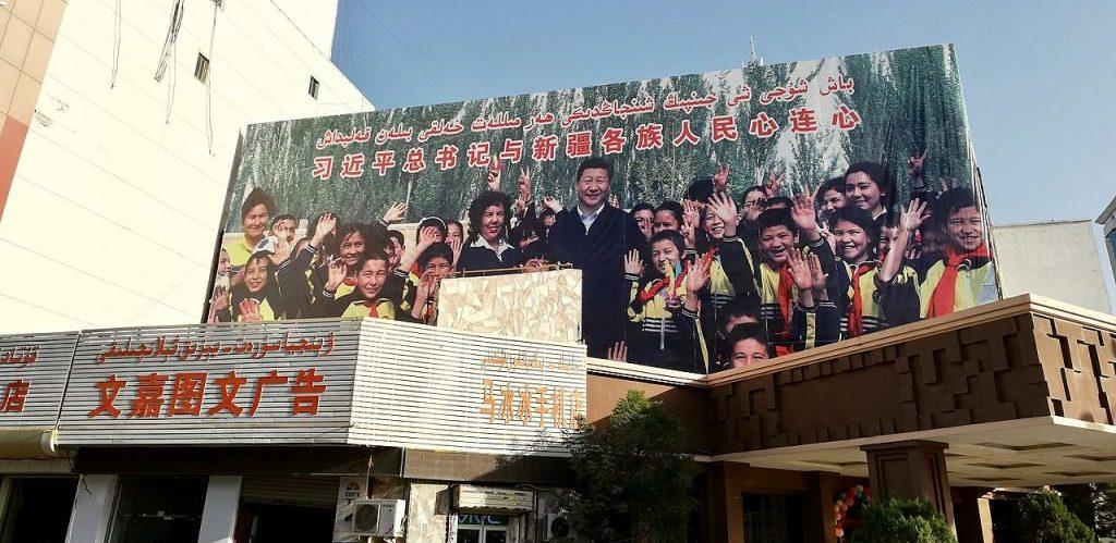 A large propaganda billboard in Kashgar Xinjiang showing Xi Jinping posing with ethnic minorities by Kubilayaxun