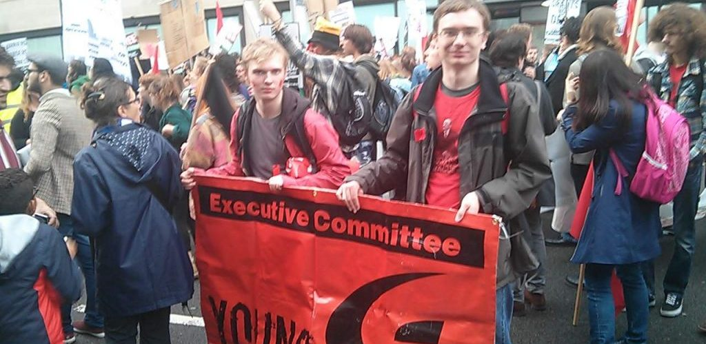 Two members of the Young Communist League holding an Executive Committee banner London by Pierre Marshall