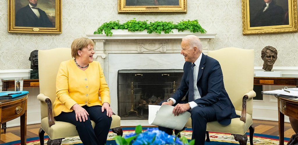 Joe Biden and Angela Merkel in the Oval Office by Office of the President of the United States