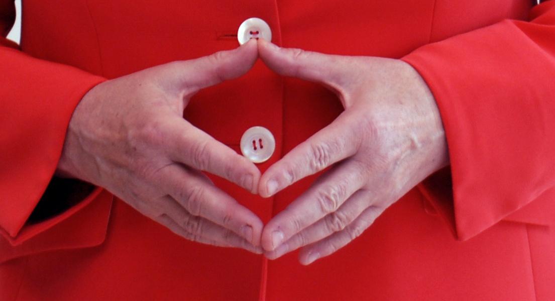 The hands of Angela Merkel forming her trademark gesture by Armin Linnartz